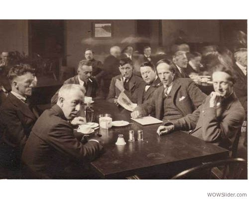 Painting Canada: Tom Thomson and the Group of Seven -     Members of the Group of Seven at the Arts & Letters Club in Toronto, c.1920  From left to right: F.H. Varley, A.Y. Jackson, Lawren Harris, Barker Fairley (not a Group member), Frank Johnston, Arthur Lismer and J.E.H. MacDonald.  Photographer: Arthur Goss / Courtesy of the Arts & Letters Club  McMichael Canadian Art Collection Archives