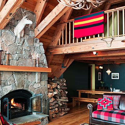 Get cabin fever: Go for a cabin-inspired look that doesn't stray into dated territory with exposed and sandblasted rafters and beams and a granite hearth.