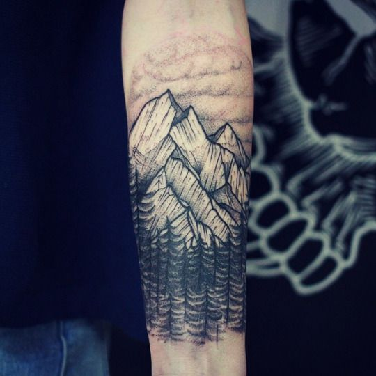 Awesomely detailed forearm tattoo of a big mountain surrounded by a fine looking pine forest. It's a great idea for all…