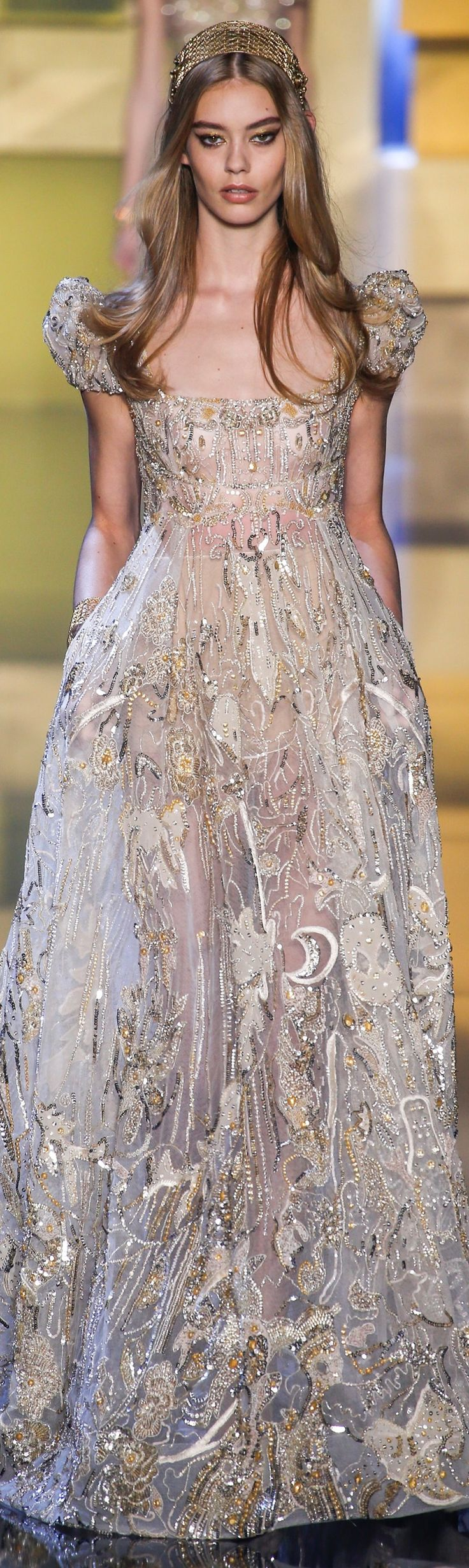 This dress reminds me of fairy tales where there are princesses of the sun, moon, and stars.