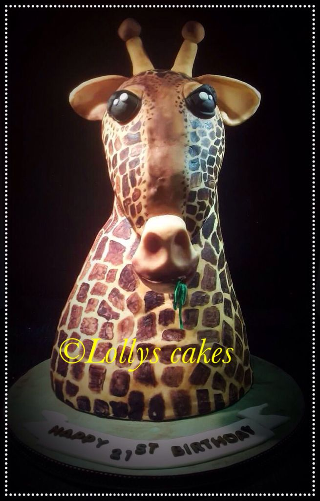 Giraffe cake carved from 3 tiers of cake.