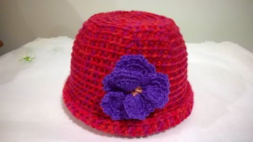 Girls Beanie with Pansy - 8 Ply Pure wool for hat and 4 Ply Pure wool for Pansy.  $20 @ the market or plus postage.