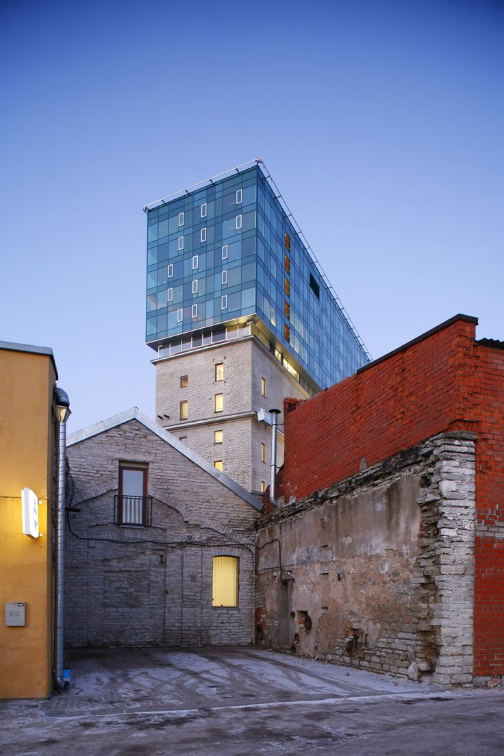 Also located in Tallinn, Estonia, is the Fahle House by KOKO Architects, a 2009 reconstruction of a former paper factory into a thriving commercial and residential space. The interior underwent a gut renovation, and the limestone building is now crowned by a sleek glass addition containing apartments.