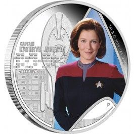 2015 Star Trek Captain Kathryn Janeway 1oz Silver Proof Coin. Star Trek: Voyager takes place in the 2370s, in the Milky Way Galaxy, and follows the adventures of the Starfleet vessel U.S.S. Voyager NCC-74656, commanded by Captain Kathryn Janeway.