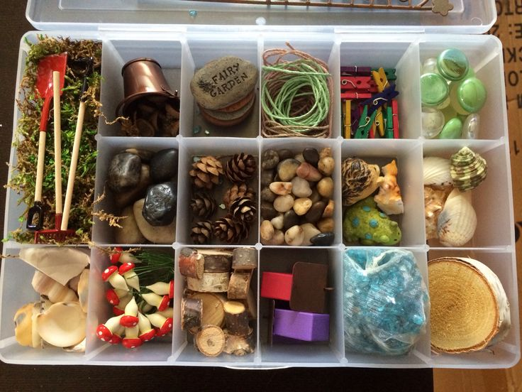 Fairy Garden starter kit.  Moss, garden tools, bucket, acorns, stepping stones, twine, mini clothes pins, color stones, river rocks- small and medium, pine cones, animals, shells, mushrooms, wood pieces, bird houses and blue glass bits.