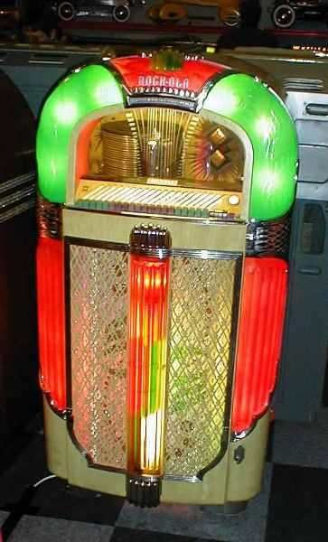 A very colorful Rock-Ola jukebox.