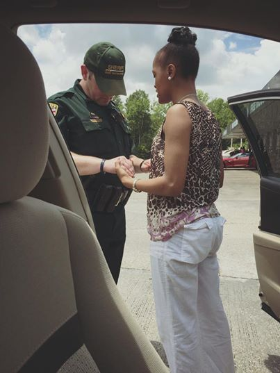 Photo Of Woman Praying With Officer Goes Viral – Law Officer