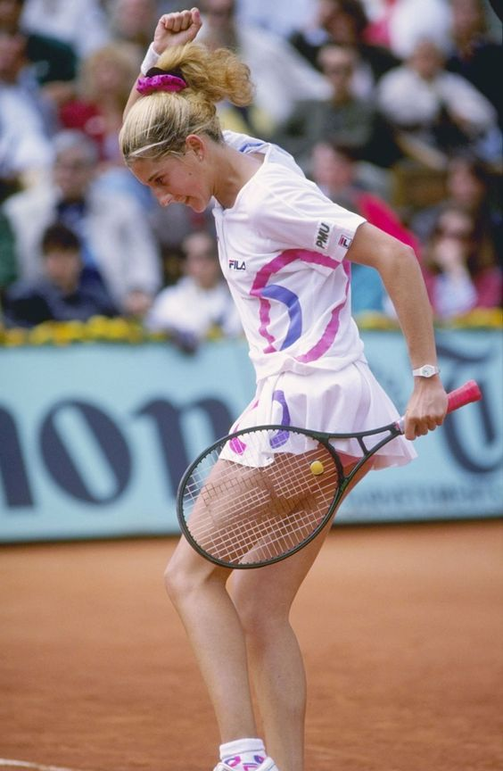 Monica Seles gives a first-pump at the 1990 French Open. Monica went on to win this tournament, and collected eight more Grand Slam Titles during her Hall of Fame career.