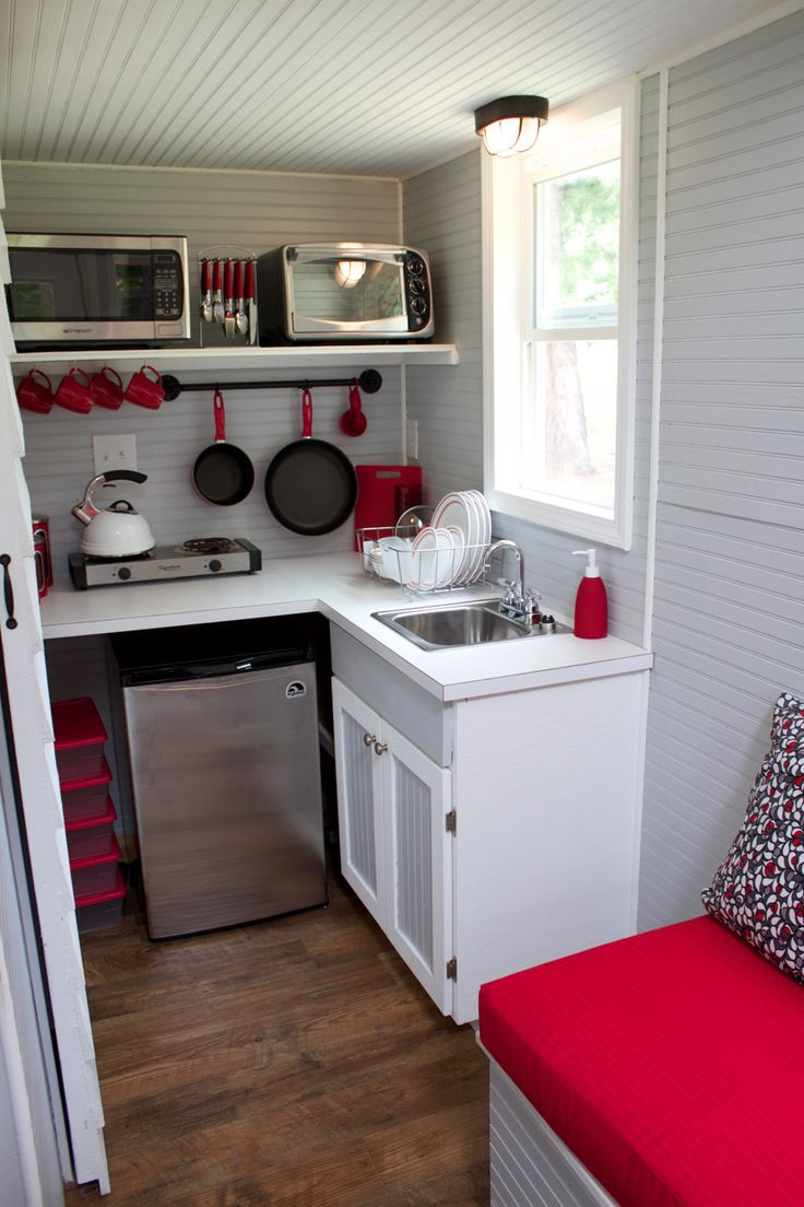 I love this small kithen, it's really all Peter and I need. I LOVE the white, but I think I'll go with a green, not red.  10-reed-tiny-house-kitchen