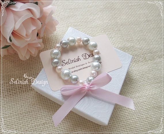 This listing is for one bracelet.    This pretty pink and grey bracelet is great for a flower girl, bridesmaids or birthday girl. It is also