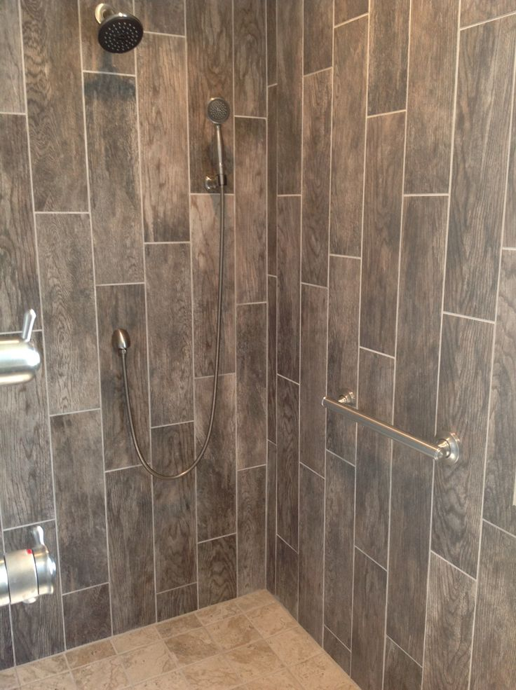 Try wood look tile on your shower walls in a random ...