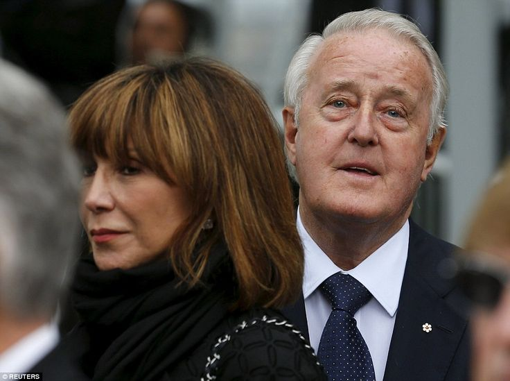 Former Canadian Prime Minster Brian Mulroney and his wife Mila look on during the Reagan's...