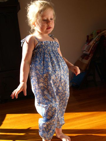 Tout Petit designed and made Liberty Tana Lawn Cotton Madsie blue jumpsuit.  Elasticised hem and smocking with straps to tie at shoulder. 100% Tana Lawn cotton, made in Denmark.   Just the one in size 2-3 $109.95