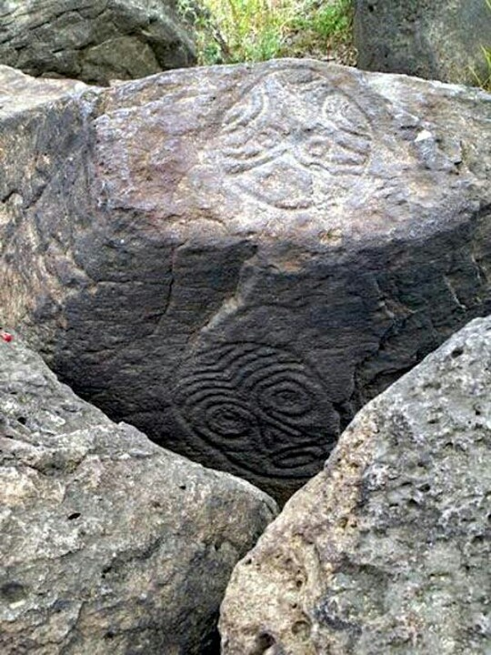 """Petroglyphs in Russia. Lower Amur River (border between Siberian Russian and Inner Manchuria in China) at Sakachi-Alyan. Some petroglyphs date back to 12000 BCE. The tribes settling along the Amur produced the human-like mask and a """"skeleton"""" style – both reflecting a type of shamanism. There are about half a million of petroglyphs known in Siberia and the Far East of Russia. (rw)"""