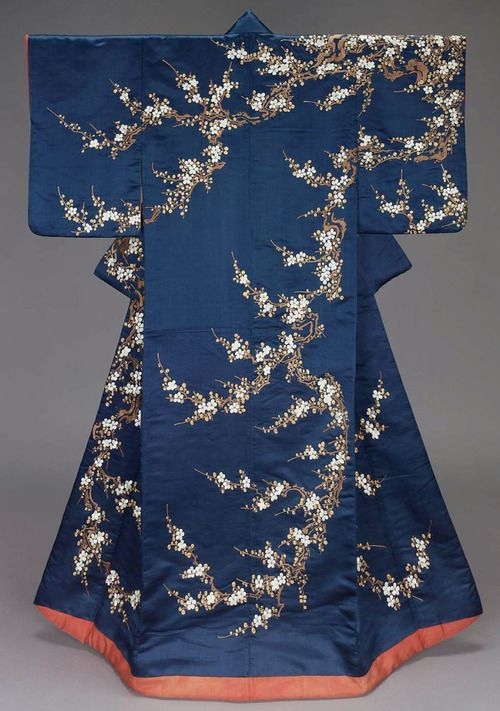 """Furisode (long-sleeved kimono), Mid-19th century, Japan. """"Furisode with shortened sleeves. Dark blue silk satin ground with design of plum blossoms embroidered with white, brown and light green silk and gilt-metallic yarns. Lined with bright red silk and padded at the bottom. Red silk crepe sleeve facings. Style favored by wealthy merchant class (chônin). Silk satin embroidered with silk and gilt-metallic yarns"""" MFA. (William Sturgis Bigelow Collection)"""