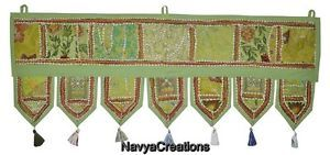 Handmade Door Decor Embroidered Design Door Hanging Indian Window Valance Toran  A fancy door toran that attracts & welcomes! This beautiful handmade toran is one of the finest Indian wall hangings that you can now online order at very reasonable price. Color combination is just perfect to attract any eye plus at the end of each decorative line it holds beautiful small tassels that make this toran overall amazing.