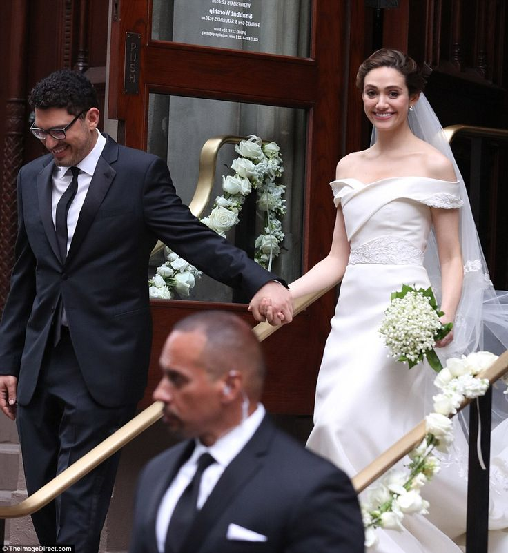 Blushing bride: Emmy Rossum looked simply stunning as she left Central Synagogue with her new husband Sam Esmail on Sunday
