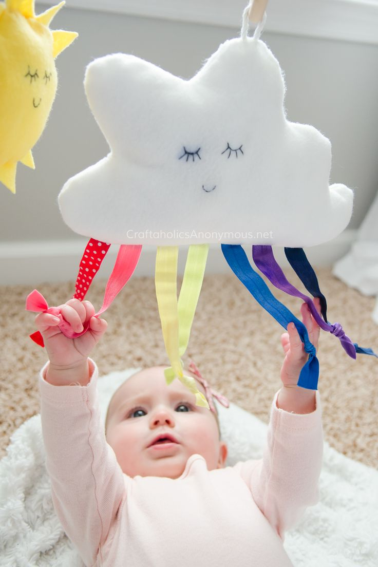 Handmade Baby Gym with rainbow cloud toy www.CraftaholicsAnonymous.net