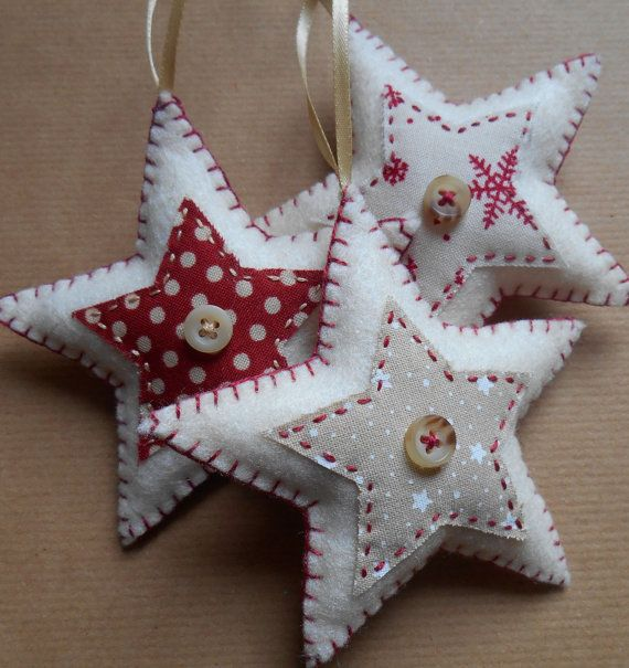 Set of three star-shaped felt christmas decorations, handmade to order.