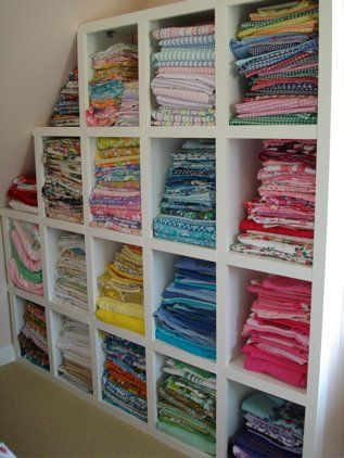Leave no corner, slanted ceiling or awkward wall bare! Sewing / craft room - shelves for fabric. @angiekkt