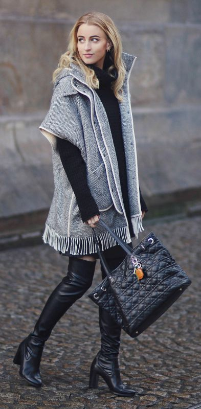 Noor De Groot demonstrates how the cape trend and over the knee boots can work brilliantly together. This oversized, marl grey cape jacket looks ultra edgy worn with a pair of tight Zalando overknee boots. Cape: Nanushka, Sweater: Drykorn, Boots: Zign via Zalando, Bag: Dior.