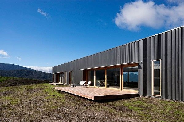 Palpable simplicity and aesthetic pragmatism define this house, which emerged from the disaster of the 2009 Black Saturday bushfires. Picture: Sonia Mangiapane.  Shed like design with front deck.