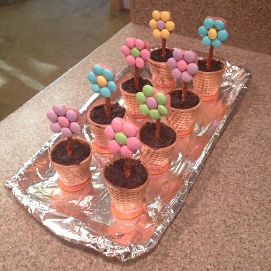 Sugar cone/Nilla wafer pots, Oreo and cream cheese dirt, and pretzel and m flowers by deanne