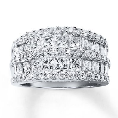 This captivating anniversary ring for her showcases rows of princess-cut diamonds alternating between rows of round diamonds, for breathtaking brilliance. Crafted of 14K white gold, the ring has a total diamond weight of 2 1/2 carats. Diamond Total Carat Weight may range from 2.45 - 2.57 carats.