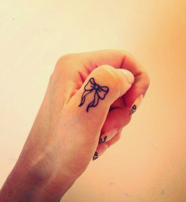 Cute Bow Finger Tattoo Designs And Ideas - dashingamrit