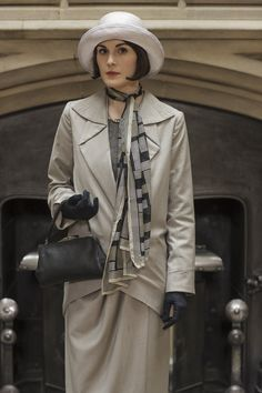 Downton Abbey Lady Mary in a light grey suit and fashionable Deco print neck scarf. The scarf was the IN accessory of the mid  1920s.