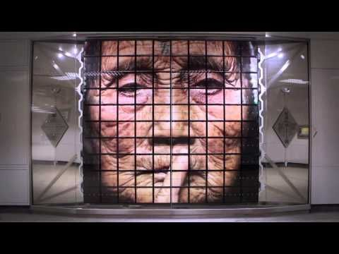 """Taiwanese artist Hsin-Chien Huang has created a kinetic installation titled """"The Moment We Meet"""".   He used split-flap displays to showcase a line-up of faces that encompass the various expressions and emotions rendered when people first meet—each flap can be individually controlled and manipulated to create a new face made up of multiple expressions of different people."""