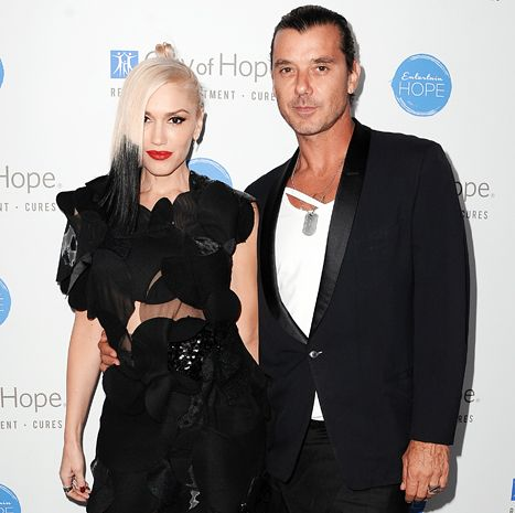 Gwen Stefani glammed up with hubby Gavin Rossdale at City of Hope event. Her look for the time is black block of hair on one side.  (2014)