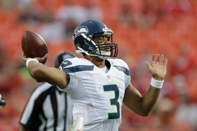 Seattle Seahawks quarterback Russell Wilson (3) passes to a teammate during the first half of an NFL preseason football game against the Kansas City Chiefs in Kansas City, Mo., Friday, Aug. 24, 2012. Photo: Charlie Riedel / AP