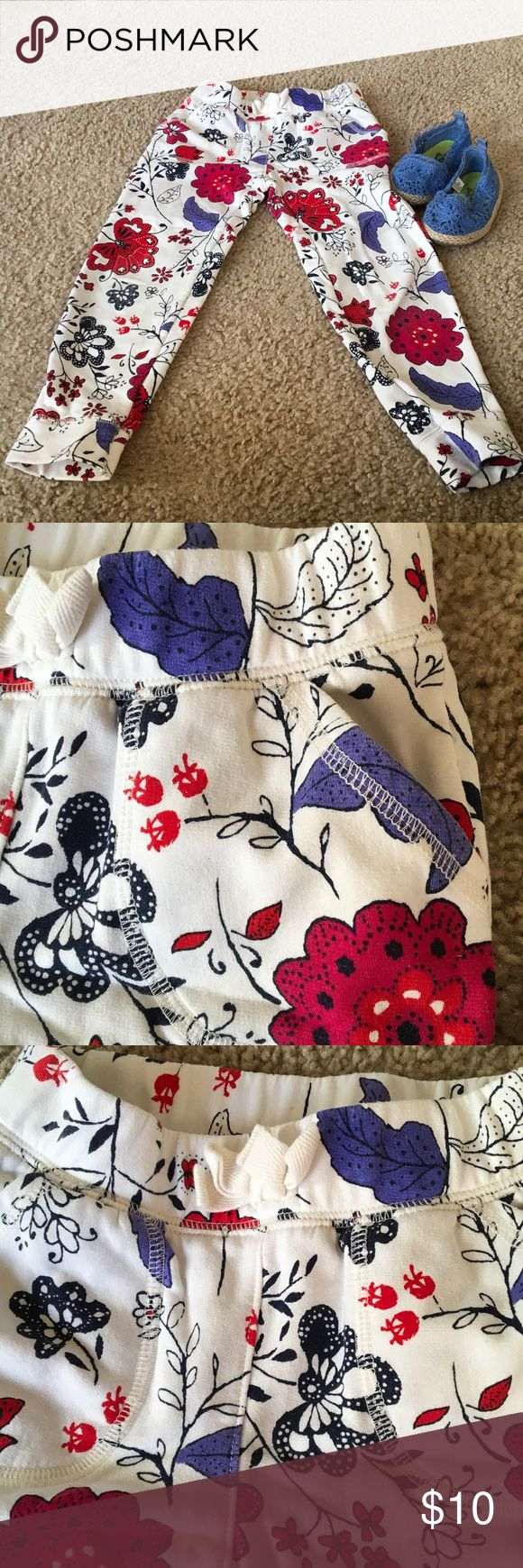 "OLD NAVY SWEAT PANT Legging FLORAL 5T ❣️🦋❣️🦋🍭❣️ White solid background w/ blossoms in navy, red and denim blue scatter all over cute comfy stretchy pants/ leggings. Made of Blend of cotton & polyester .elastic waistband w drawstring. 5T 20 1/4""around Waistband unstretched...7 3/4"" RISE ....18 1/8"" inseam....4"" leg opening. Old Navy Bottoms Leggings"