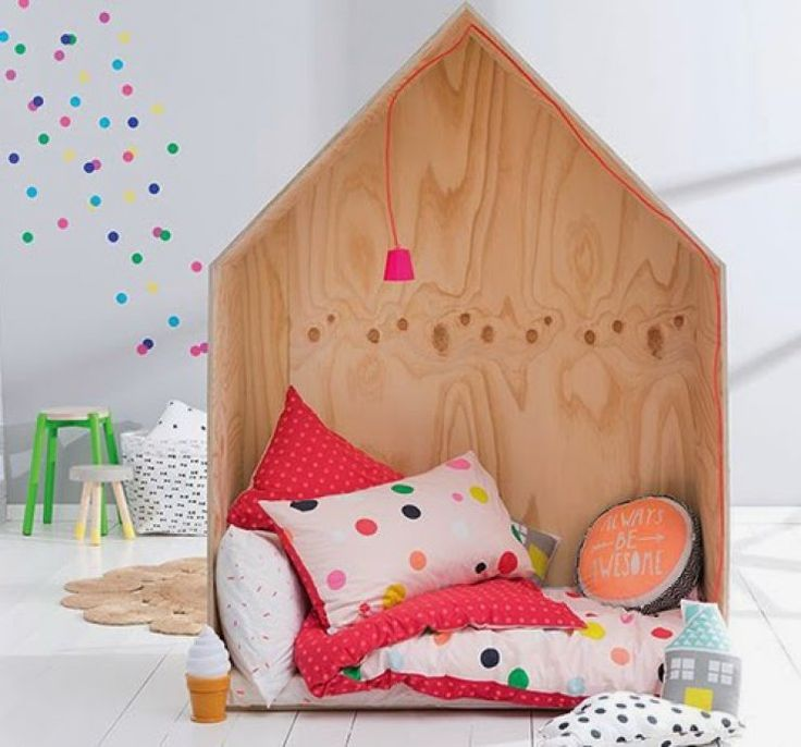 little wooden house as reading nook for kids