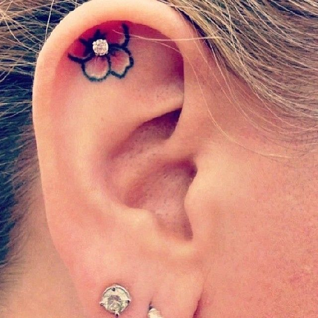 Flower earring tattoo. I would never get a tattoo on my ear. It would be WAY to painful. IMO, tattoos should be something you want people to see so they know more about you without you having to tell them.