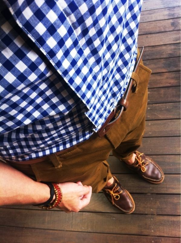 Shop this look for $135: http://lookastic.com/men/looks/brown-belt-and-brown-boat-shoes-and-tobacco-chinos-and-white-and-blue-longsleeve-shirt/818 — Brown Leather Belt — Brown Leather Boat Shoes — Tobacco Chinos — White and Blue Gingham Longsleeve Shirt