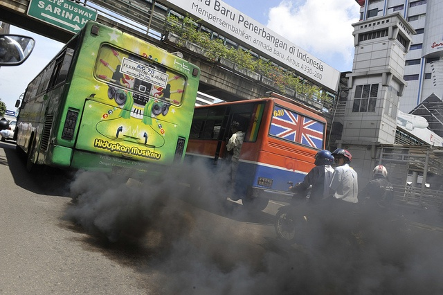 A commuter bus running on diesel fuel emits thick trail of pollutants in Jakarta on December 7, 2009. Current pledges from rich and developing nations for cutting carbon pollution will stoke potentially catastrophic warming by century's end, accordin green houses are going to improve our value of life.