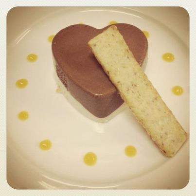Romance on a plate...  Chocolate and coconut mousse, passion fruit heart, almond biscuit