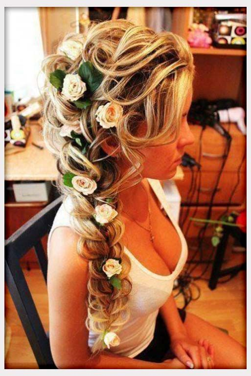 Flower in the hair. Braid. Style: down