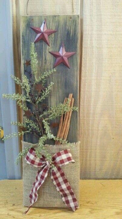 "Prim Board...with a burlap ""pocket"" & metal stars...stuffed with cinnamon sticks & a sprig of pine."