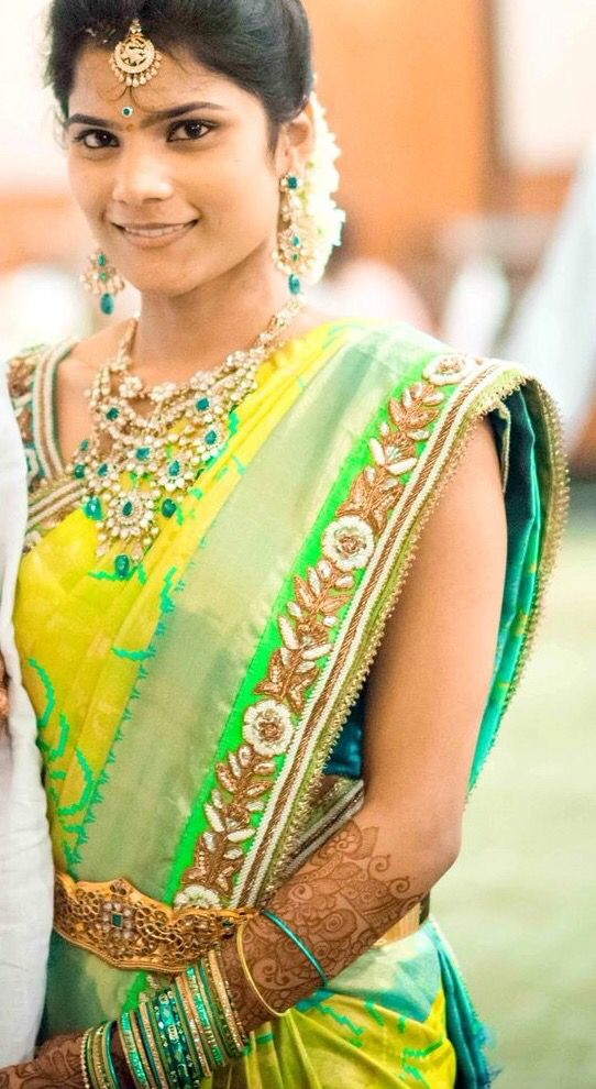 South Indian bride. Temple jewelry. Jhumkis.Yellow and green silk kanchipuram sarees.Braid with fresh flowers.Tamil bride. Telugu bride. Kannada bride. Hindu bride. Malayalee bride.Kerala bride.South Indian wedding.