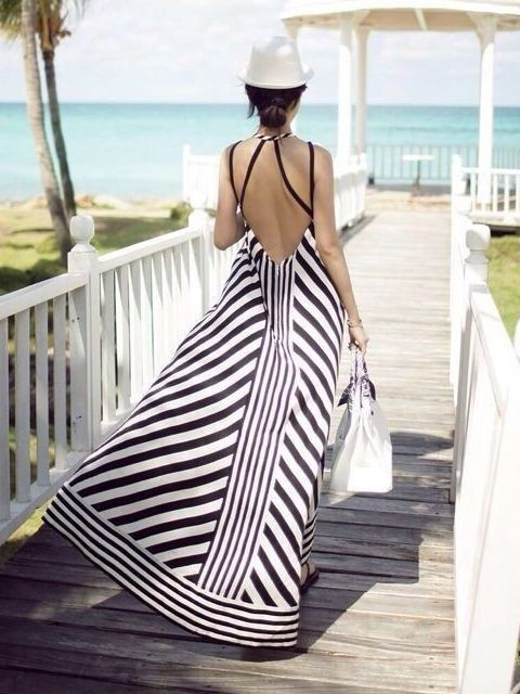 Large bold stripes in a long maxi dress against the Maldives beaches