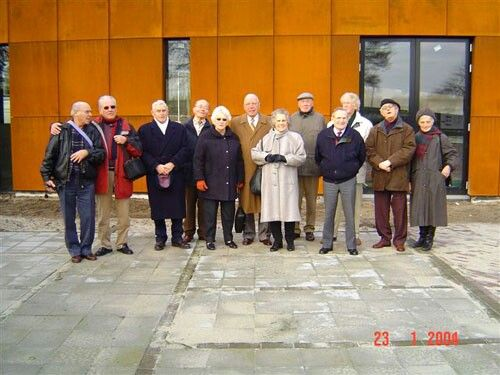 A group of former KZ prisoners in the newly build Nationaal Monument Kamp Amersfoort in January 2004. My dad, front row, third from the right. Second from the right, Herman Roering who passed away on Dec. 22, 2014 at the age of 90.