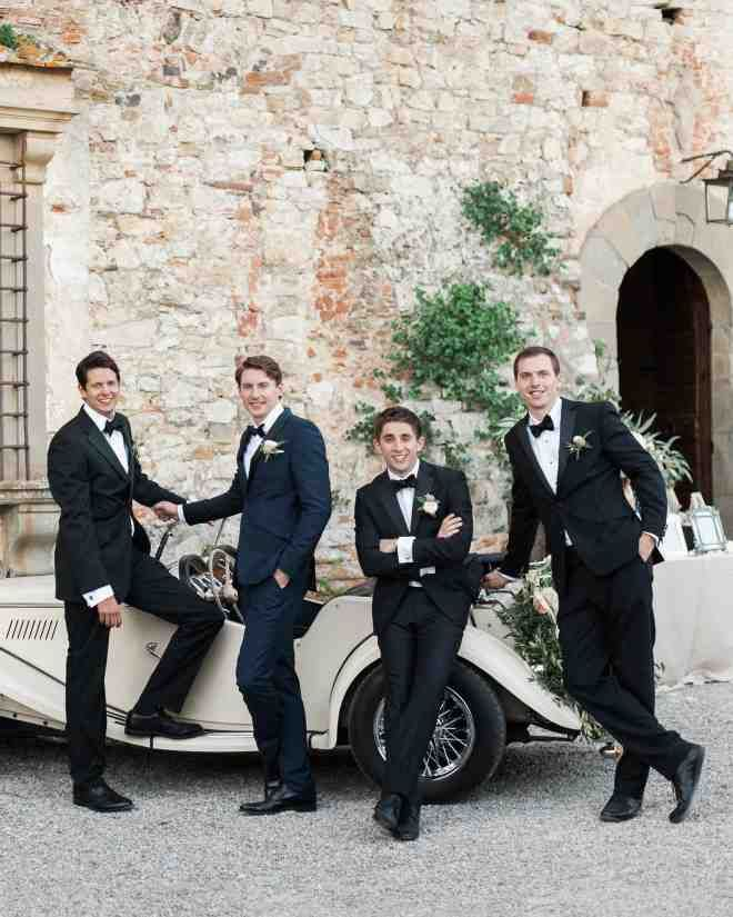 Clad in black tuxes and bow ties, Ollie's groomsmen were his three best college buddies.