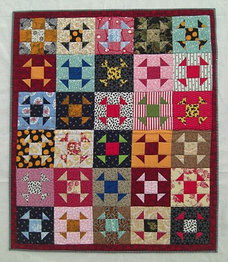 Shoo-Fly Wall Quilt by Karen Griska with free-pieced blocks