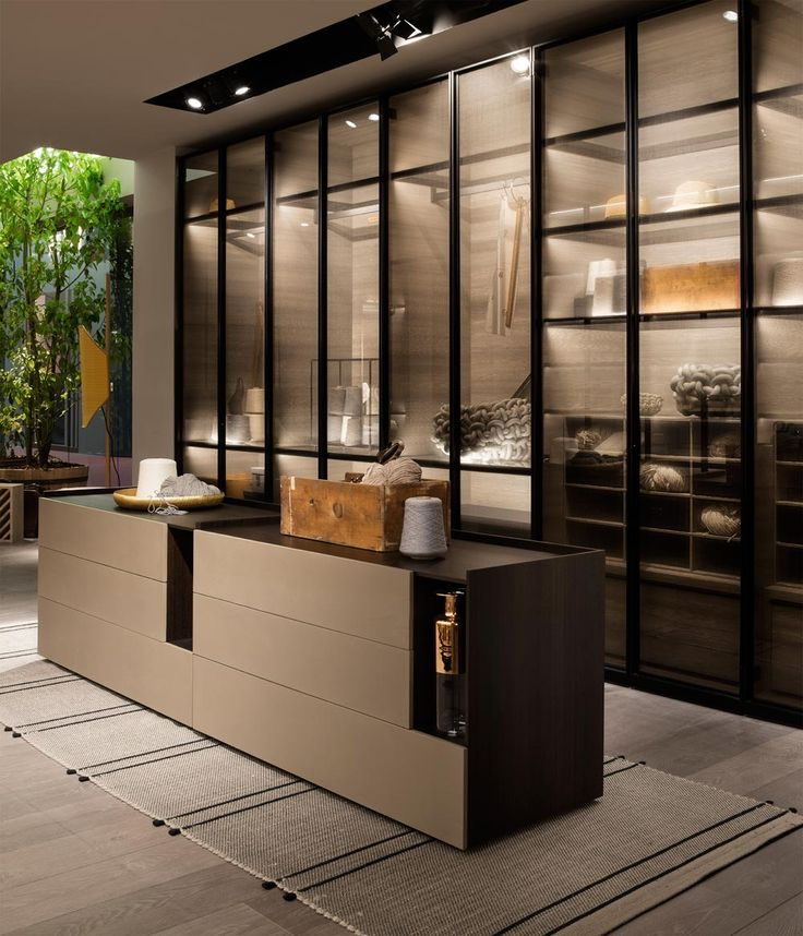 DANDY closets with doors in glass and fabric, interiors in grey larch wood with glass shelves and external sides in thermo-treated oak. At the center, the new TIP drawer unit by Daniel Debiasi and Federico Sandri in thermo-treated oak with the front sides of the drawers in Pepe Clay. TIP is a proposal characterized by a modern and essential language. Lema S.p.A. Salone del Mobile, Design Week 2016