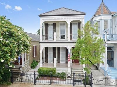For sale: $665,000. Beautiful restored 1900's Italianate, one block from St. Chas, streetcar & parade route!. 100 yr Vermont slate roof, handcrafted shutters replaced 2015. Dbl galleries, original pocket doors, Cypress wdwork, medallions, wd floors, custom cherry cabinets. Great architectural details & wonderful light throughout. Large master bedroom, floor to ceiling windows opening to balcony. Large wood deck, deep fenced back yard, in-ground sprinkler system. Security system pl...