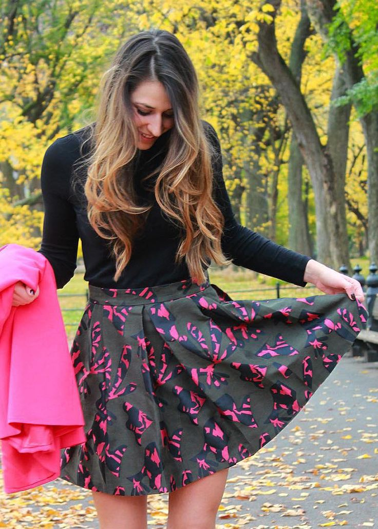 Andrea Pion styles our pink, black, and green printed fit-and-flare skirt with a fitted black top and hot pink blazer for a playfully chic fall look | Banana Republic