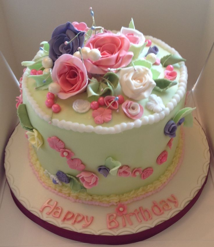 A pretty Rose topped Cake.